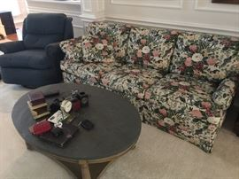 Floral sofa, slate top oval coffee table