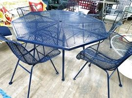 Richard Russell Sculptura dining set restored in a navy powder coated finish.