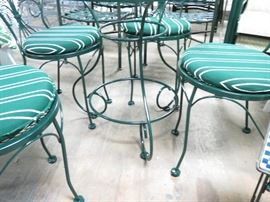 Vintage Woodard bistro set includes 4 chairs w/ cushions and round table. Restored in a powder coated forest green finish.