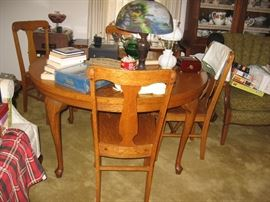 Golden Oak round table with chairs.
