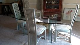 This is a large glass table with 6 chairs. The brass center piece would look really nice painted is a satin black