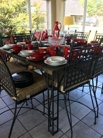 Dining in style!  Red stoneware and white banded gold china