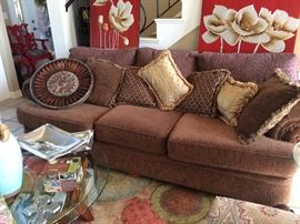 Comfy and classic sofa!  Pillows, rug and tables.