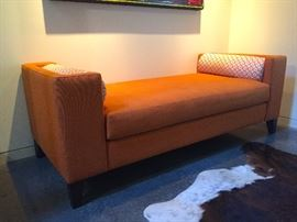 Custom Orange Fabric Bench with Bolster Pillows.