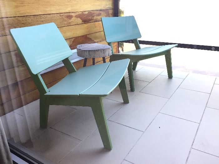 Loll Lago Green Outdoor Lounge Chairs (4). Tree Stump Tables (2).