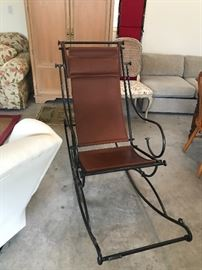 Ilana Goor Design from The Quiet Moose.   Leather and Iron Rocker.  Other items from Ilana Goor are 4 barstools and matching side chairs.