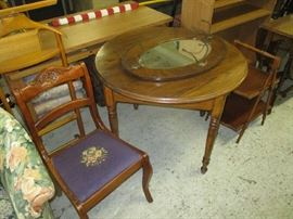 Round oak table and needlepoint chair