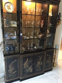 Asian China/Curio Cabinet with Gold Back and lit glass shelves.  Cabinet doors below with shelves.  Excellent Condition!