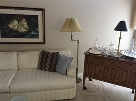 Beautiful sectional sofa, framed art, Stiffel swing arm lamp, Drexel Heritage bar cart filled with Waterford items :)