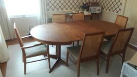 "Drylund Dining Room Table with 6 chairs with 2 20"" extensions 87"", 47"" round in Teak with tile and teak serving table table pads"