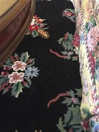 Closer view of wool black and floral area rug