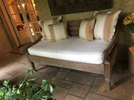 Antique wooden bench upholstered