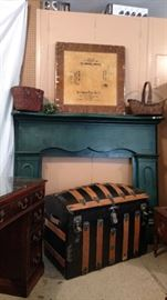 Vintage mantle, card table with advertising, vintage baskets and trunk