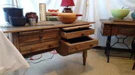 Cast Iron Pots, vintage bowls, sewing machine case (no machine) wonderful bakers table