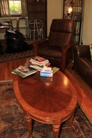 side table, rug, leather reclining chair