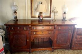 """Large credenza with intricately carved doors. 6'6"""" length, 2' depth, 3' height - $1950.00"""