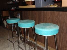 Set of six mid century modern swivel bar stools