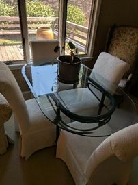 Glass top dining table and fabric covered chairs