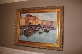 Oil painting in gilt frame depicting a harbor