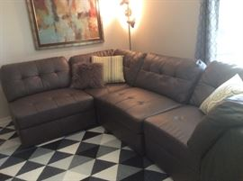 Like-new leather sectional, contemporary artwork, wool area rug