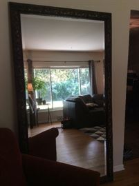 Large mirror with carved frame, also has wire for hanging horizontally