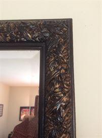 Detail, carved frame floor mirror