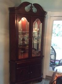 Vintage cherry lighted breakfront cabinet