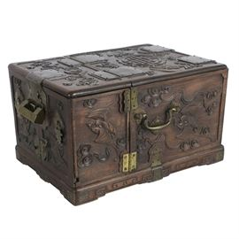 19th Century Chinese Carved Rosewood Vanity Box with Mirror: A 19th century Chinese carved rosewood vanity case, designed to be compact for travel with handles at each side. The outer box is carved with auspicious symbols and flying bats, then brass hardware and a geometric carved pattern at the base. The hinged top frames the mirror which props open revealing the four inner drawers and two storage boxes that swing outward. The original brass lock and key are present and working.