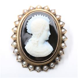 "Onyx ""Francoise De Remini"" Cameo Brooch in 14K Yellow Gold Setting with Pearls: An onyx carved cameo brooch signed to the back Francoise De Remini mounted in 14K yellow gold with seed pearls at the edge."