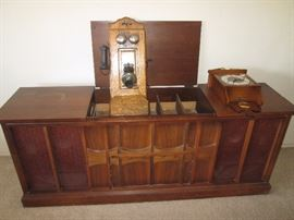 Great looking Stereo Console Cabinet.  Note the wall-mount Clock and old Telephone unit!