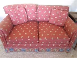 Rust colored Love Seat by Benchcraft of Hickory