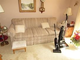 Sofa, vacuums and lamps