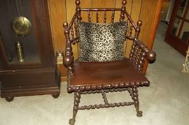 A very unusual chair graces the foyer of this house.  We would love to know the history behind this chair...what an addition to an antique collection.
