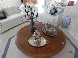 Another shot of the coffee table, sectional and silver coffee service.