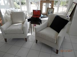 Matching pair custom ivory brocade upholstered chairs in top shelf condition.  Were covered with sheets .