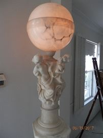 Solid Marble sculpture Greek lamp.  Sits on solid white marble column.