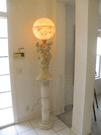 The total picture of the Greek solid marble sculpture lamp sitting on solid white marble fluted column....notice security system pad on the left
