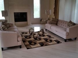 Eames Atomic tempered glass end tables and coffee table, sculpted area rug....COUCHES SOLD