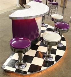 Super Cool – (see video)  1950's Retro Vintage Style Bar on black and white on lighted floating wheeled floor.   The 2 door bar has 5 attached swiveling stools   Also has 5 Piece Pub Set with swiveling bar stools.  Vitro Seating Products made in the USA