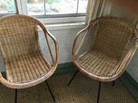 Midcentury iron and wicker chairs