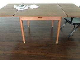 Sleek Midcentury modern expandable danish teak Diningroom table