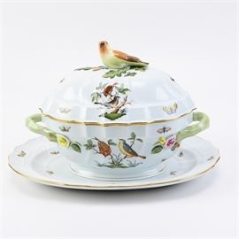 "Herend ""Rothschild Bird"" Tureen and Underplate: A Herend Rothchilds Bird tureen and underplate. This pattern was designed for the Rothschild family with a special decorative element of a pearl necklace on the tree in the pattern of birds on a branch. The tureen features a bird finial, applied flowers and green naturalistic handles. Printed factory marks on the underside read ""Herend Hungary Handpainted"" together with a pattern number ""1102 /No C52"" in blue."