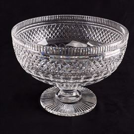 "Waterford Crystal Compote: A Waterford crystal compote. This piece is made of clear crystal by Waterford with a small diamond shaped pattern of cuts, two tiered pedestal, and circular base. ""Waterford"" is etched on the underside."
