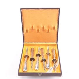 "Prata Wolff Brazilian Silver Plate Corkscrew Set: A set of Brazilian silver plate corkscrews by Prata Wolff. This six piece set comes in the original box. Each piece features rounded handles and a narrow long screw end. They are marked ""Prata Wolff""."
