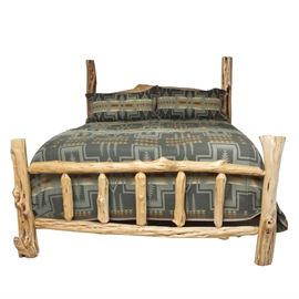 King Size Rustic Bed Made from Cedar: A rustic king sized bed made from cedar wood. This piece has been fashioned from a collection of cedar posts which form the bed posts, footboard, and headboard. The bedding is not included. Mattress and box spring are optional.