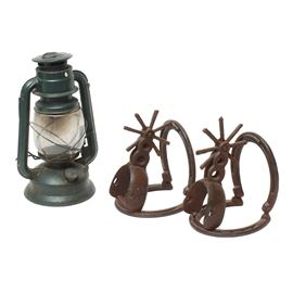 Decorative Southwestern Items: A decorative pair of distressed bookends in the shape of spurs and horseshoes. Also included is a rustic green metal lantern with a glass insert.