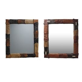 Leather Cowboy Boot Mirrors: A pair of leather cowboy boot mirrors. This pair of mirrors features a variety of cowboy boot tops attached together to form the frame of a mirror. All the cowboy boots are unique, some plain and some with tooled leather. The mirrors are ready for hanging.