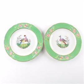 Copeland Spode English Plates: A pair of English Spode plates from Copeland. Both of these plates have gilt exterior and interior edges with green and floral trim between. Along the center of either is a bird depiction, and to the underside are marks that bring both from England and Spode.
