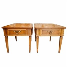 "Pair of ""Pavane"" End Tables by Tomlinson: A pair of Pavane end tables by Tomlinson. Each table features a rectangular top overhanging bump out apron sides with exposed dovetail joinery corners and cockbeading trim work. The tables each include a drawered front with decorative pull and rise up on tapering and fluted legs. The pair include a ""Tomlinson"" label to the interior of a drawer."