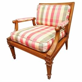 "Hollywood Regency Style Armchair by Tomlinson: A Hollywood Regency style armchair by Tomlinson. This chair features a gently bowed back including tapering column spindles with raised arms including curved supports and upholstered, inset armrest. The chair includes plaid upholstered cushions and it rises up on tapering block legs ending in tapered feet. The piece is marked to the decking ""Tomlinson""."